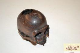 A Japanese wooden skull Netsuke