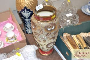 A Royal Doulton red and gilt decorated vase