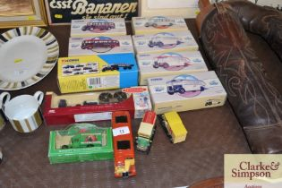 A quantity of boxed Corgi buses etc, and other die