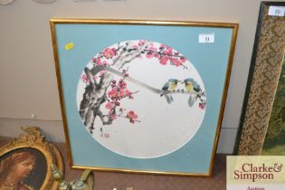 A Chinese painting depicting birds amongst blossom