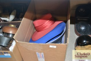 A box containing various lady's hats