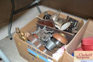 A box of various metal ware