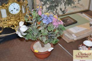An artificial jade type floral encrusted bonsai tr