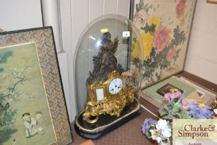 A French clock by L.A.Fontaine contained under gla