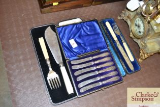 A cased set of silver handled butter knives; and o