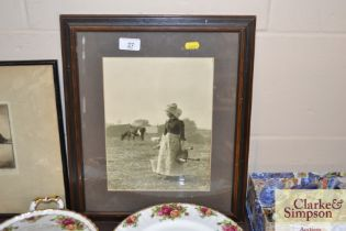A black and white photographic print of a milkmaid