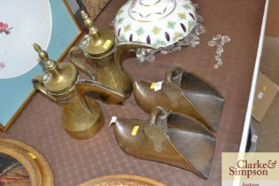 A pair of brass stirrups; and a pair of Eastern br