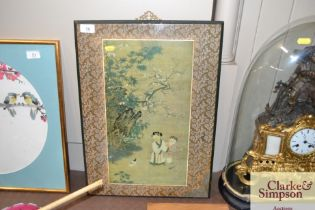 A Chinese print depicting two children and a kitte