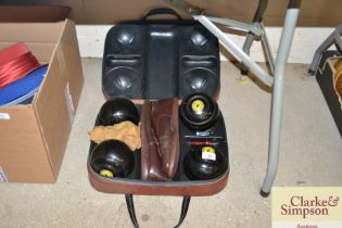 Four bowling woods in fitted case etc.