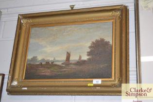 A gilt framed oil on board study depicting barges;