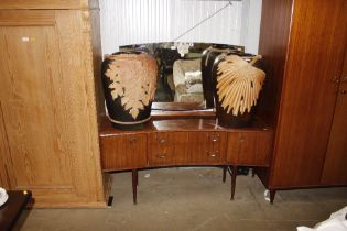 A mirrored teak dressing table