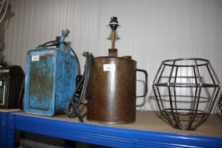 A table lamp in the form of an oil can