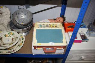 A Fisher Price School Days desk; John Lewis Domino