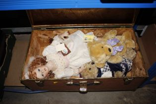 A storage trunk and contents of dolls and soft toy