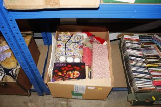 A box of various Christmas decorations