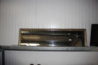 An oblong wall mirror