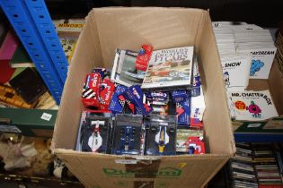 A box of various boxed Corgi model F1 cars etc.