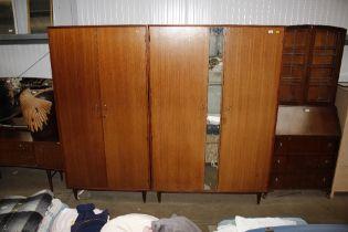 Two mirrored teak wardrobes