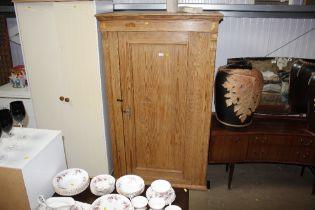 A pine single door wardrobe