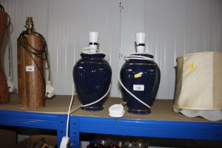 A pair of table lamps lacking shades