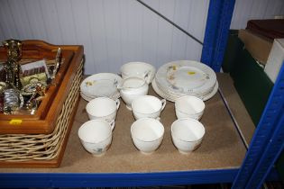 A quantity of floral patterned teaware