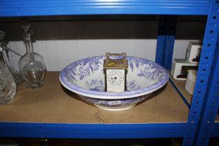 A wash bowl and mantel clock