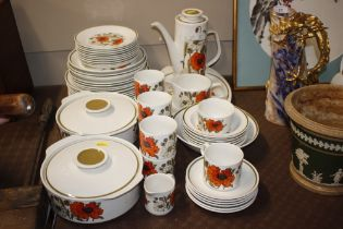 A Meakin poppy decorated coffee/dinner service