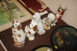 Two pairs of Staffordshire dogs, one AF, and two o