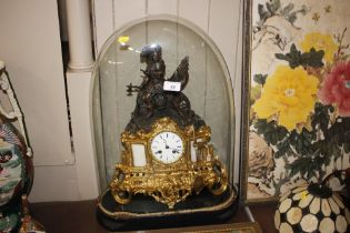 A 19th Century gilded mantle clock under glass dom