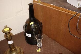 An antique green glass bottle and a sherry schoone