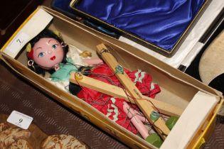 A Pelham standard puppet in box
