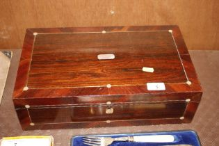 A 19th Century rosewood and mother of pearl inlaid