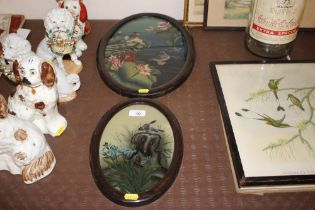 A pair of oval framed reverse painted pictures dep