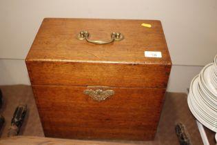 A Victorian golden oak and brass mounted cutlery b