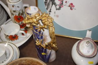 A Doulton gilt dragon decorated jug (chipped)