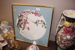Chinese painting depicting birds amongst blossom