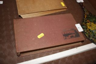 A sun and shade vintage photograph album and conte