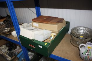 A box containing various sewing items