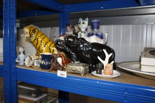 A quantity of decorative ornaments and china to in