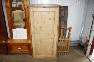 A stripped pine cupboard