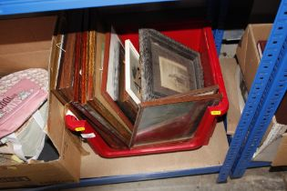 A box of various pictures and prints