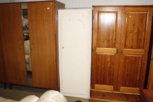 A white painted single door wardrobe