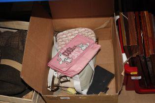 A box containing lady's handbags
