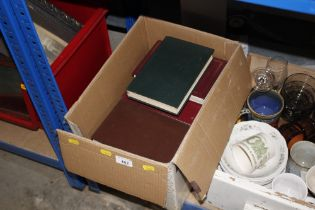 A box of various Readers Digest books