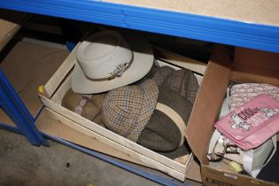 A wooden crate of various hats