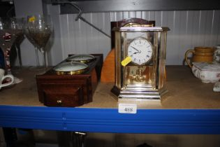 An anniversary clock together with two mantle cloc