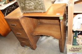 An Art Deco desk fitted with three drawers