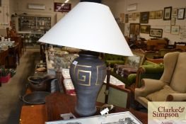 A large modern pottery table lamp and shade
