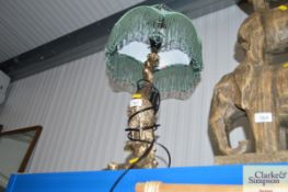 A table lamp in the form of a peacock and shade