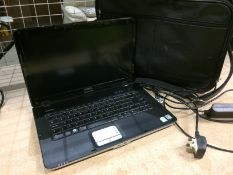 A Dell Vostro PP37 notebook computer complete with adapter and black vinyl laptop bag